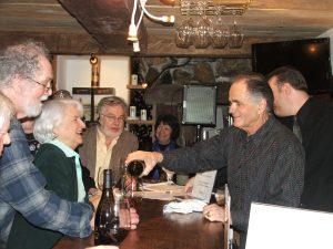 Nello Olivo pouring wine