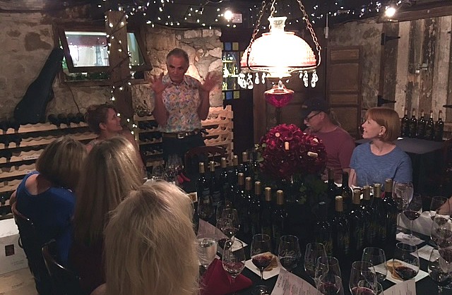 Nello Olivo entertaining a private cellar tasting group.